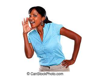 Adult woman screaming and looking at you on blue blouse...