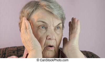 Adult woman sitting indoors covers face hands - Adult woman...