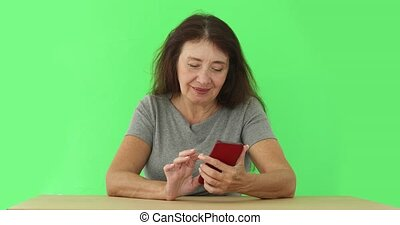 Adult woman using phone on chromakey