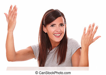Adult woman with her hands up looking at camera