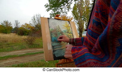 Adult Woman With Long Brown Hair Drawing A Picture At Plein Air