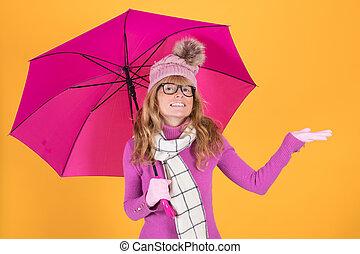 adult woman with warm umbrella checking the rain