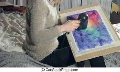 Adult women paint with colored watercolor paints and dry...