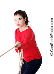 Adultl woman pulling a rope