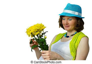 adulto, mujer embarazada, sentado, con, un, flor amarilla