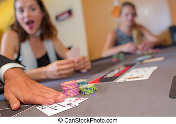 Adults around casino table