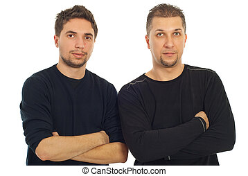 Two adults cousins standing with arms folded isolated on white background