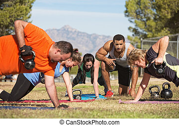 Adults Exercising Outdoors - Fitness instructor with people...