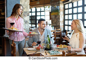 Adults having dinner and waiter - Portrait of smiling adults...