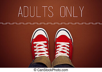 Adults Only Concept, Young Teenage Person in Red Sneakers Standing at Dividing Line of Restricted Area.