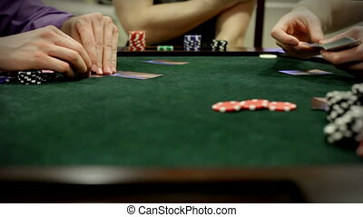 Adults playing poker card game