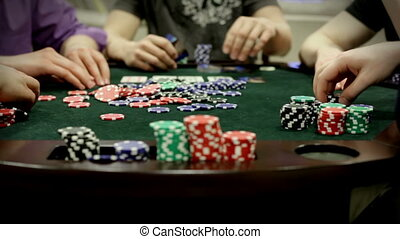 Adults playing poker card game - A group of adults...