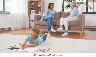 adults talking and girl drawing at home - family, leisure...