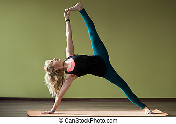 Advanced variation of Side Plank Pose - Portrait of sporty ...