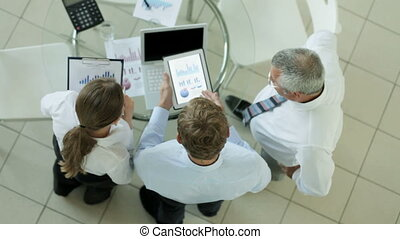 Advantages of modern technology - Business team of three...