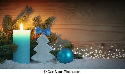 Advent candle and blue decoration with snow. Christmas...