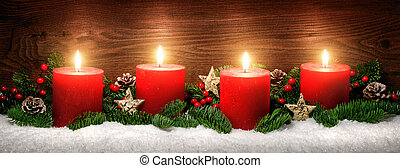 Advent decoration with four burning candles