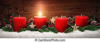 Advent decoration with one burning candle