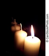 Advent first candle - Inflamed candle on first sunday of...