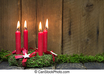 Advent or christmas wreath with four red wax candles. - ...