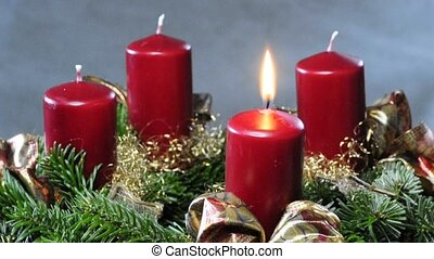 advent wreath - first candle on an advent wreath is burning
