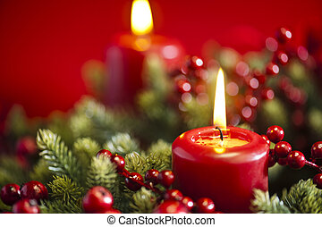 Advent wreath over red background with winter rose and ...