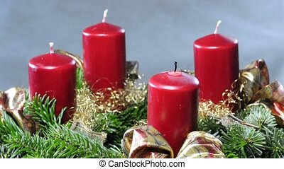 advent wreath - ignating the first candle on an advent...