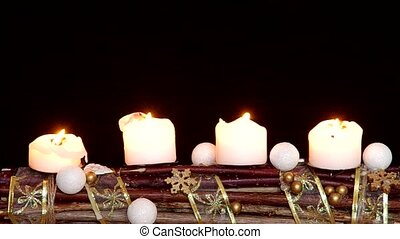 Advent wreath with white candles on a black background