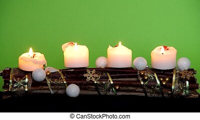 Advent wreath with white candles on a green background