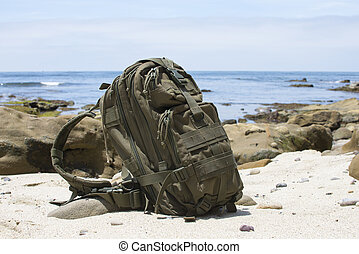 Adventure backpack on sand with ocean in background - Green...