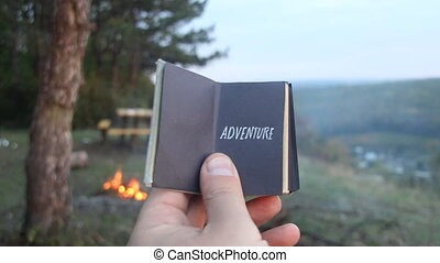ADVENTURE. Book with the inscription
