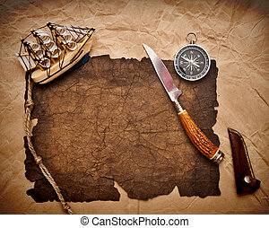 old paper, rope, compass, decorative knife and model classic boat on very old paper
