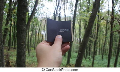 adventure idea, book with text, forest in the background