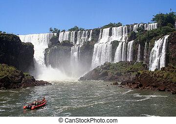 a boat is navigating between the iguazu falls