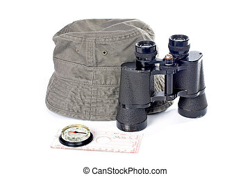 Adventure kit - Hat, compass and binoculars on a white...