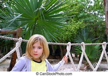 adventure little girl on jungle park rope bridge