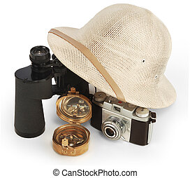 adventure - safari pith helmet leaning against binoculars ...