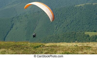 adventure sport in summer season. - Two people flying on...