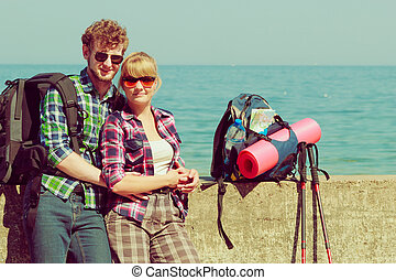 couple backpacker tramping by seaside - Adventure, summer,...