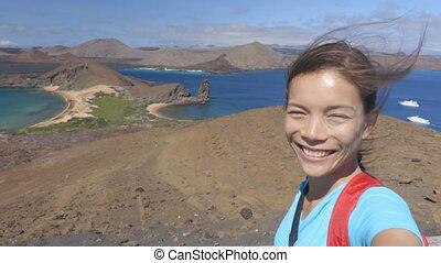 Adventure travel - Galapagos tourist selfie video on...