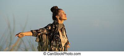 adventure traveller woman rejoicing - adventure traveller...