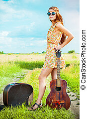 adventure vogue - Romantic girl travelling with her guitar....