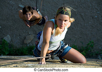 Adventure - Woman and man engage in extreme sports