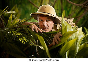 Adventurer peeking through plants - Adventurer hiding and ...