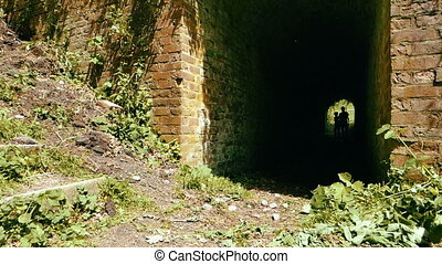 adventurous kids with flashlights coming out of a tunel