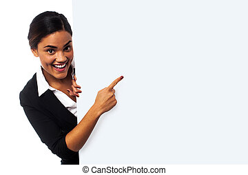 Place your business ad here. Woman pointing at blank whiteboard