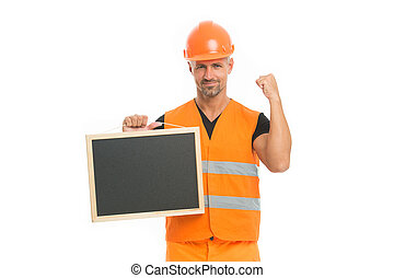 Advertisement concept. Builder enjoy success. Strong handsome builder hold blackboard. Successful engineer. Man protective hard hat uniform white background. Worker builder confident and successful