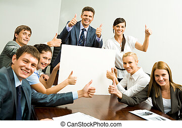 Advertisers - Portrait of business people with thumbs up...