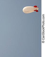 Advertising blimp - A blank advertising blimp in a blue sky