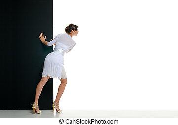 Advertising board - Woman pull black billboard on empty ...